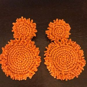 Big orange beaded earrings